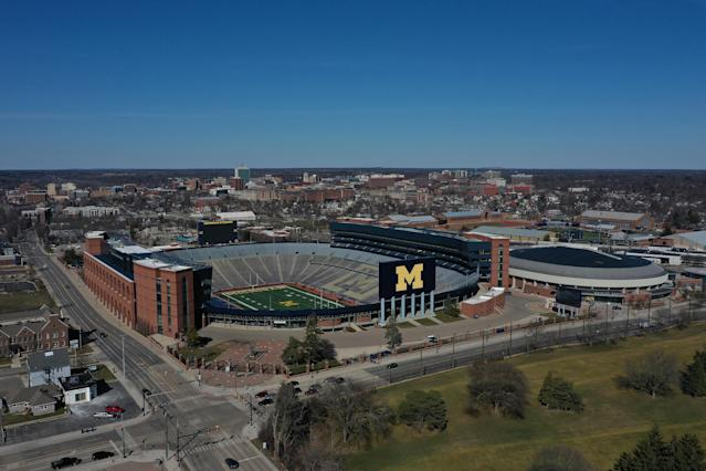 Michigan Stadium holds more than 107,000 fans, but Jim Harbaugh said he would be OK playing with it empty in order to play football. (Photo by Gregory Shamus/Getty Images)