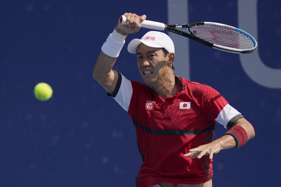 Kei Nishikori, of Japan, plays Ilya Ivashka, of Belarus, during the third round of the tennis competition at the 2020 Summer Olympics, Wednesday, July 28, 2021, in Tokyo, Japan. (AP Photo/Seth Wenig)