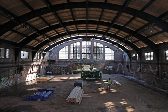 The New Rochelle Armory is covered with graffiti and peeling paint after years of neglect.