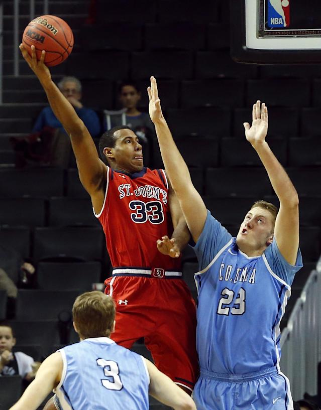 St. John's Orlando Sanchez (33) takes a shot as Columbia's Cory Osetkowski (23) defends during the first half of an NCAA college basketball game at the Barclays Center, Saturday, Dec. 28, 2013, in New York. (AP Photo/Rich Schultz)
