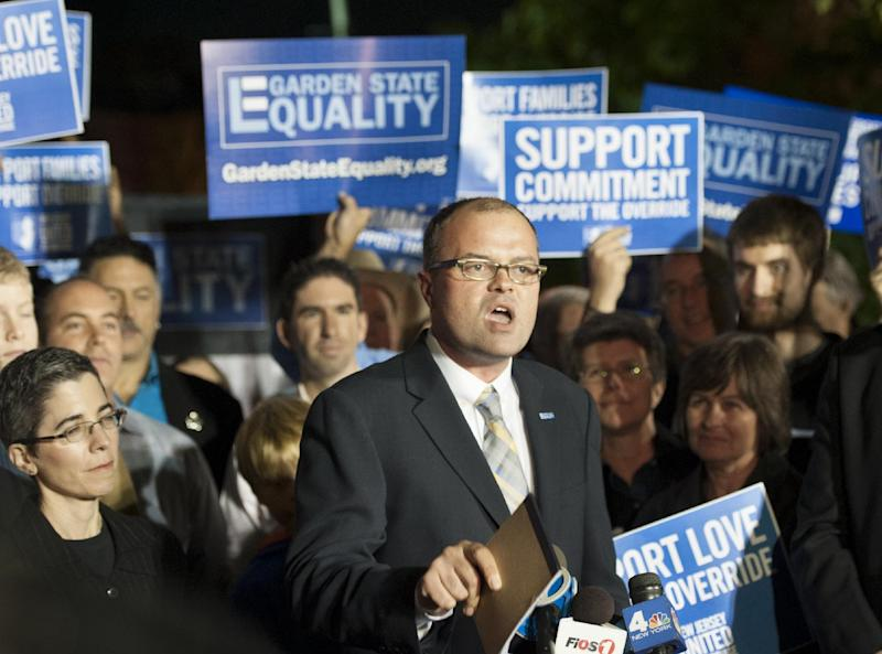 Troy Stevenson, Executive Director of Garden State Equity, addresses a crowd of about 150 people gathered on the lawn in front of their office Friday Oct. 18, 2013, in Montclair, N.J. The rally followed a state Supreme Court ruling that the state must begin granting same-sex marriage licenses. (AP Photo/Joe Epstein)