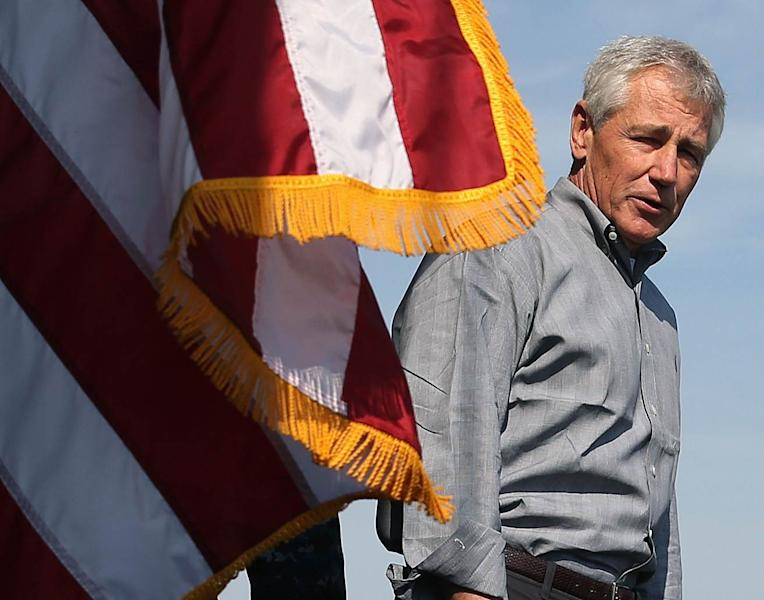 U.S. Secretary of Defense Chuck Hagel speaks to military servicemembers aboard the USS Ponce in Manama
