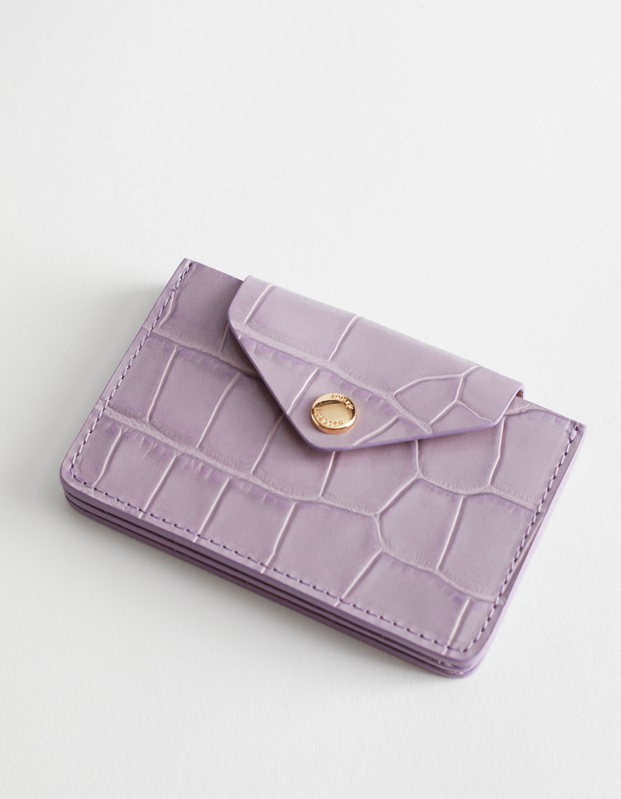 "Because her cards deserve a home as chic as her handbag. $49, & Other Stories. <a href=""https://www.stories.com/en_usd/bags/wallets/product.leather-card-holder-purple.0536289035.html"" rel=""nofollow noopener"" target=""_blank"" data-ylk=""slk:Get it now!"" class=""link rapid-noclick-resp"">Get it now!</a>"