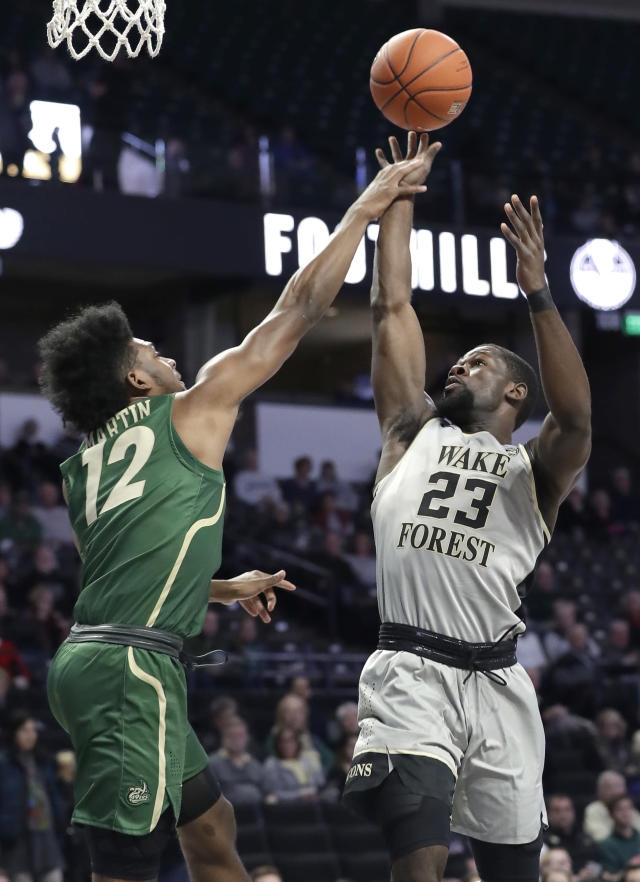 Wake Forest's Chaundee Brown (23) shoots over Charlotte's Malik Martin (12) in the first half of an NCAA college basketball game in Winston-Salem, N.C., Thursday, Dec. 6, 2018. (AP Photo/Chuck Burton)