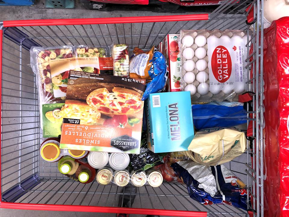 A customer's cart filled with the supplies they're purchasing in response to news about coronavirus disease (COVID-19) at Costco Wholesale on Still Creek Drive in Burnaby, British Columbia, Canada March 15, 2020. Picture taken March 15, 2020.REUTERS/Alec Jacobson.