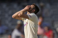 England's Mark Wood reacts after bowling during the fourth day of the Test match between England and New Zealand at Lord's cricket ground in London, Saturday, June 5, 2021. (AP Photo/Kirsty Wigglesworth)