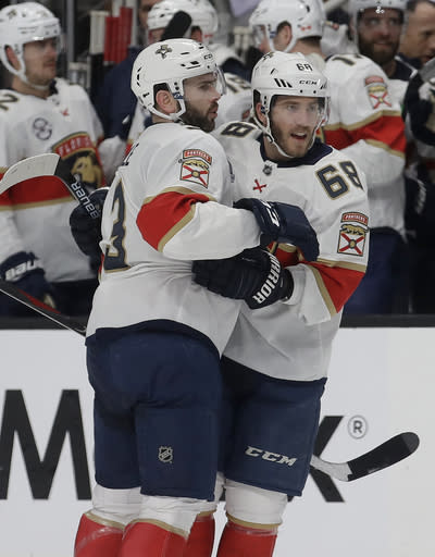 Florida Panthers left wing Mike Hoffman, right, celebrates with Keith Yandle after scoring a goal against the San Jose Sharks during the second period of an NHL hockey game in San Jose, Calif., Thursday, March 14, 2019. (AP Photo/Jeff Chiu)