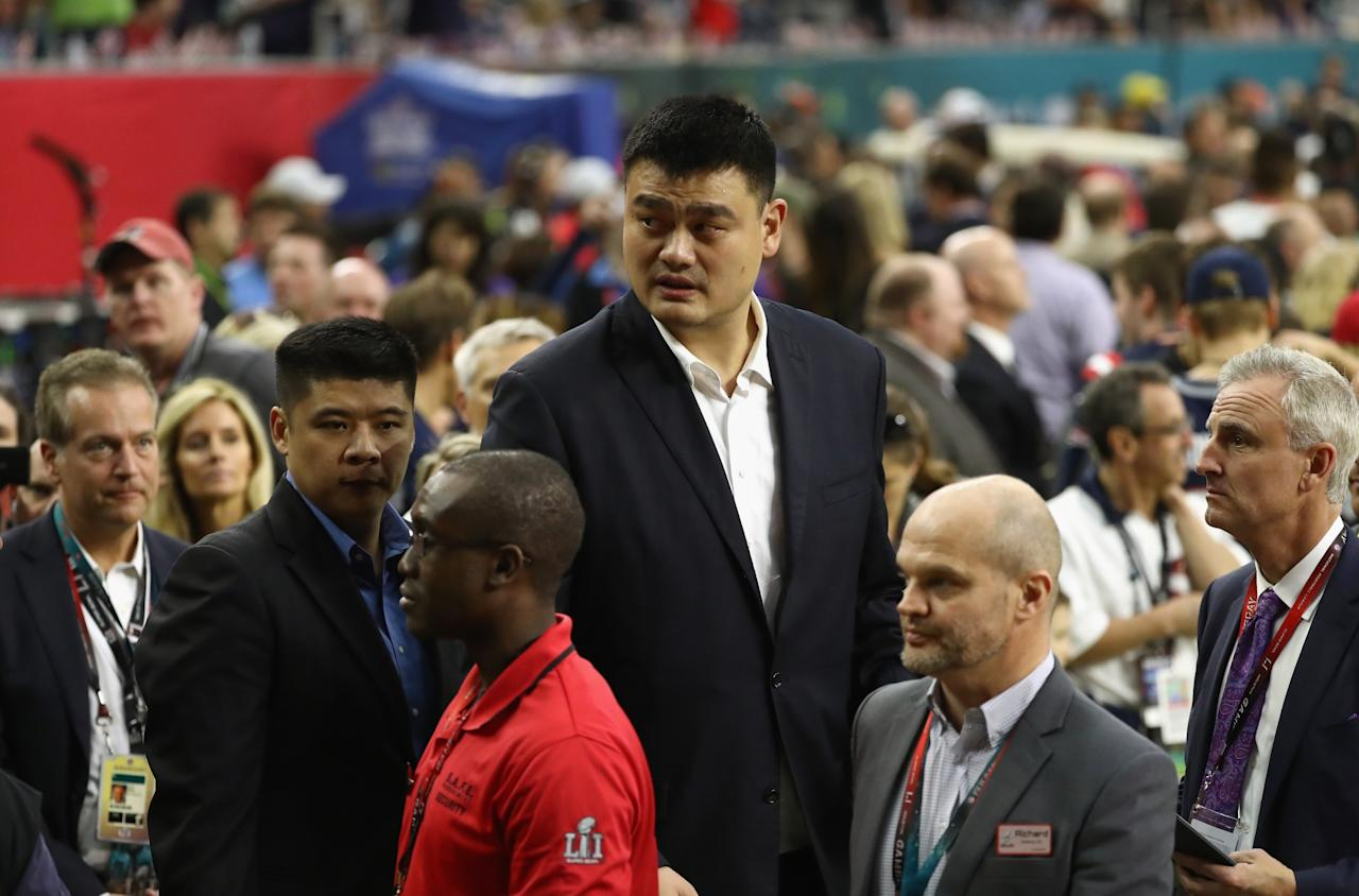 <p>Former Houston Rocket and NBA Hall of Famer Yao Ming walks on the sideline before Super Bowl 51 between the Atlanta Falcons and the New England Patriots at NRG Stadium on February 5, 2017 in Houston, Texas. (Photo by Elsa/Getty Images) </p>