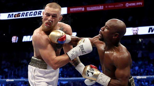 Mayweather whacks McGregor during his victory in Vegas. Pic: Getty