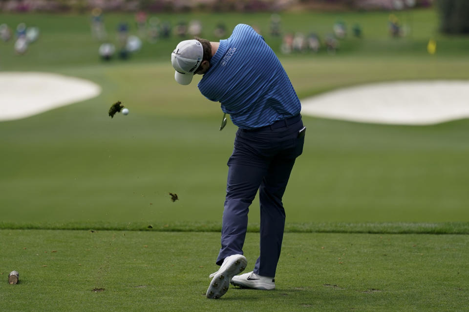 Robert MacIntyre, of Scotland, tees off on the fourth hole during the final round of the Masters golf tournament on Sunday, April 11, 2021, in Augusta, Ga. (AP Photo/Charlie Riedel)