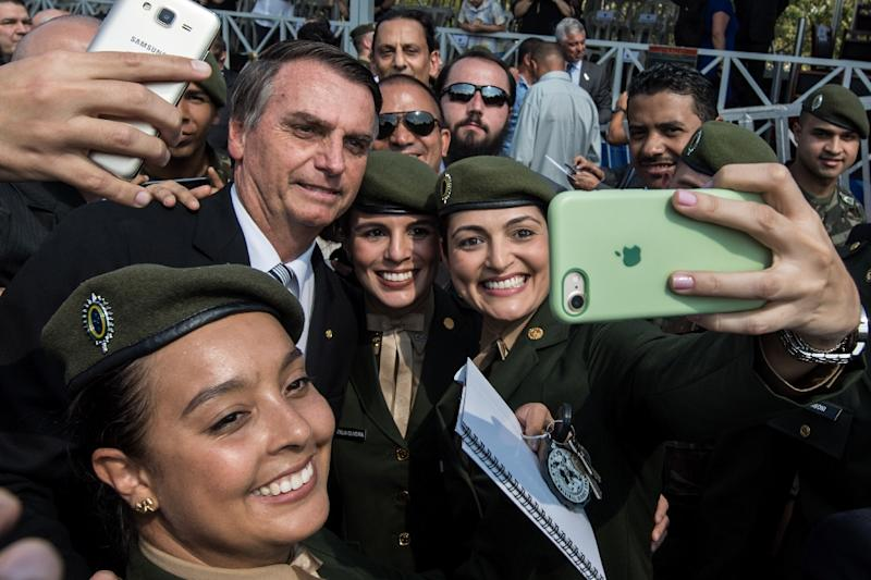 Brazilian presidential candidate Jair Bolsonaro, seen here at an event in Sao Paulo in May, has shown particular appeal among the young (AFP Photo/Nelson ALMEIDA)