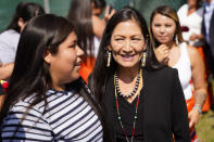 Interior Secretary Deb Haaland meets with young people from the Rosebud Sioux Tribe after a ceremony at the U.S. Army's The disinterred remains of nine Native American children who died more than a century ago while attending a government-run school in Pennsylvania were headed home to Rosebud Sioux tribal lands in South Dakota on Wednesday after a ceremony returning them to relatives. (AP Photo/Matt Rourke)
