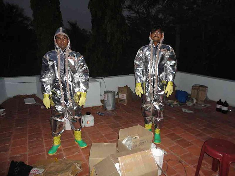 Two members of the Narcotics Control Bureau during a raid in the Sivaganga district of Tamil Nadu (AFP Photo/Narcotics Control Bureau)