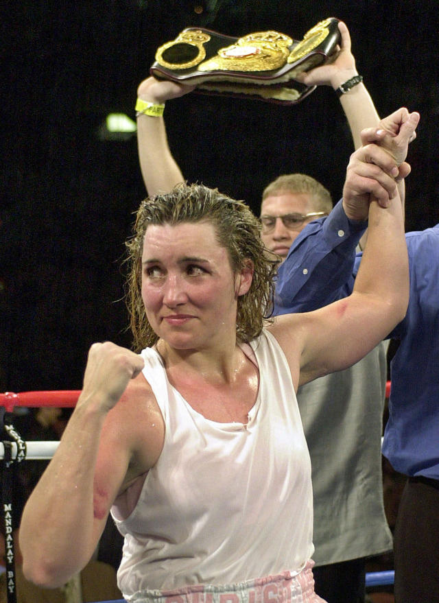 "FILE - In this March 3, 2001, file photo, Christy Martin looks toward her corner following her unanimous 10-round decision over Jeanne ""Boom Boom"" Martinez, in Las Vegas. Martin was elected to the International Boxing Hall of Fame, Wednesday, Dec. 4, 2019. This was the first year that women were on the ballot. (AP Photo/Kevork Djansezian, File)"
