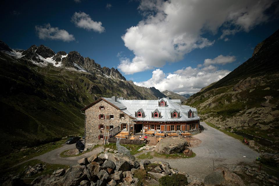 Visitors sit on the terrace of the Jamtal hut near Galtuer, Austria. (Photo: Lisi Niesner/Reuters)