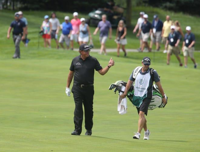 Phil Mickelson approaches the green on 13 and acknowledges the applause from the gallery during the opening round of the Northern Trust Golf Tournament part of the PGA Tour being played at Liberty National Golf Club in Jersey City on August 19, 2021.