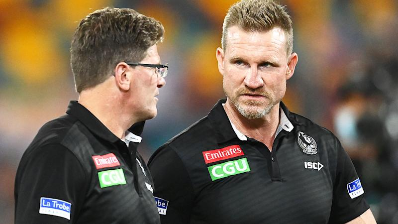 Nathan Buckley, pictured here talking to assistant coach Robert Harvey.