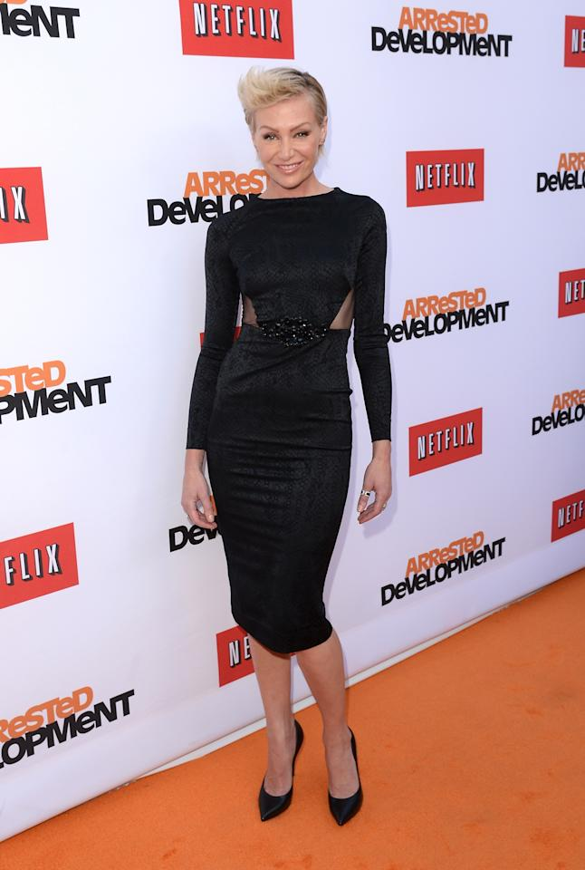 "HOLLYWOOD, CA - APRIL 29:  Actress Portia de Rossi arrives at the TCL Chinese Theatre for the premiere of Netflix's ""Arrested Development"" Season 4 held on April 29, 2013 in Hollywood, California.  (Photo by Jason Merritt/Getty Images)"