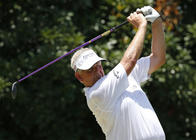 Colin Montgomerie hits off the third tee during the final round of the U.S. Senior Open golf tournament at Oak Tree National in Edmond, Okla., Sunday, July 13, 2014. (AP Photo/Sue Ogrocki)