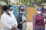 Nanah Sheenaz, left, Batamuliza Stella, center, and Nakandi Hanipher, right, drivers for Uganda's new all-female ride-hailing service Diva Taxi, examine a pepper spray as they learn self-defense skills in Kampala, Uganda Monday, Sept. 28, 2020. Uganda's latest ride-hailing service Diva Taxi has recruited over 70 drivers ranging from college students to mothers wishing to make good use of their secondhand cars, breaking the mold in the socially conservative country by hiring only female drivers. (AP Photo/Ronald Kabuubi)