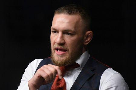 FILE PHOTO: Oct 21, 2017; Gdansk, Poland; Conor McGregor reacts as Artem Lobov (red gloves, not pictured) fights Andre Fili (blue gloves, not pictured) during UFC Fight Night at Ergo Arena. Per Haljestam-USA TODAY Sports