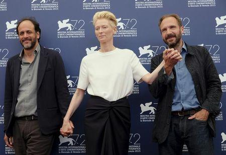 "Director Luca Guadagnino (L), actress Tilda Swinton and actor Ralph Fiennes (R) attend the photocall for the movie ""A Bigger Splash"" at the 72nd Venice Film Festival"