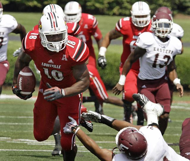 Louisville's Gerald Christian (18) strides away from Eastern Kentucky's Christian Albertson (31) after this pass reception in the second half of their NCAA college football game in Louisville, Ky., Saturday, Sept. 7, 2013. (AP Photo/Garry Jones)