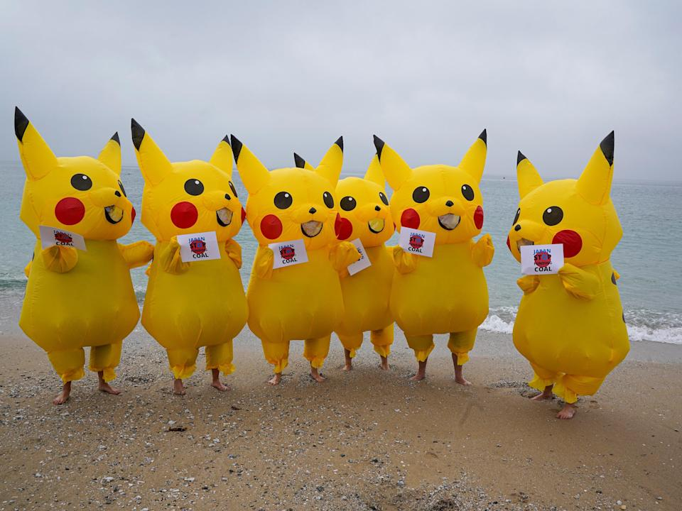 Protesters dressed as Pikachu characters demonstrate on Gyllyngvase Beach, Falmouth (Getty Images)