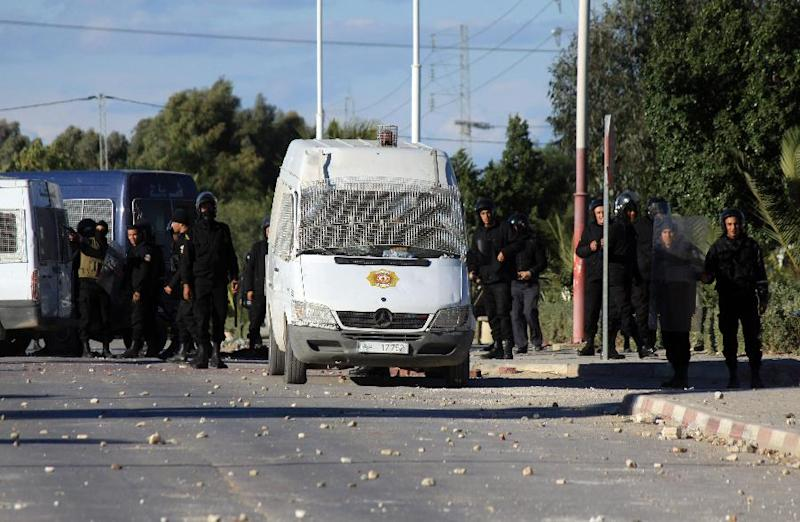 Tunisian riot police officers face demonstrators (unseen) during clashes in Siliana, Tunisia, Friday, Nov. 30, 2012. Tunisia's Prime Minister accused opposition parties and unions Thursday of provoking three days of violent clashes in Siliana and pleaded for patience while the government tackles the nation's economic problems. (AP Photo)