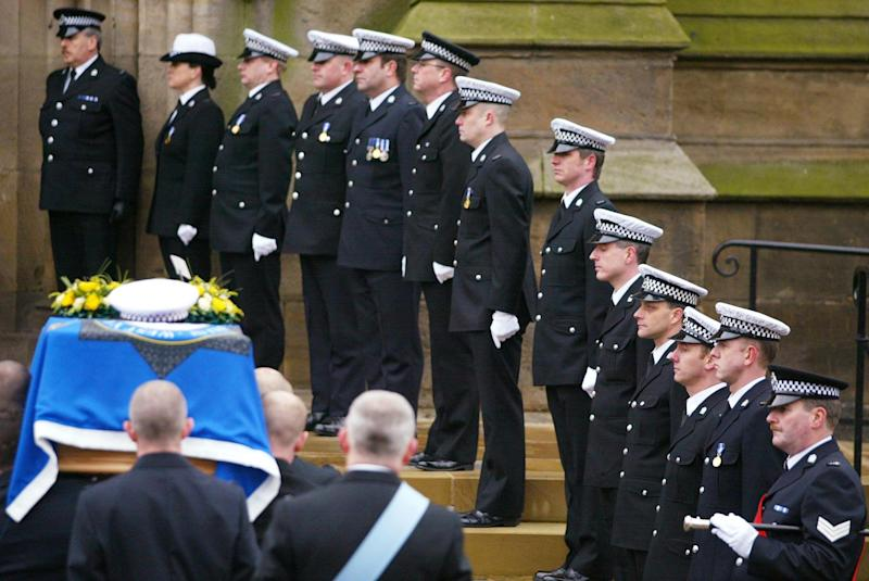 Pc Neil Roper (fifth right) lines-up with fellow Police officers as the coffin of their colleague Pc Ian Broadhurst is carried during a funeral service at Leeds Parish Church in Kirkgate, West Yorkshire. Pc Roper survived the incident in which Pc Broadhurst, 34, from Birkenshaw, West Yorkshire, was shot twice while helping to arrest American David Bieber in Dibb Lane, Leeds, on Boxing Day. 2/12/04: Former US Marine David Bieber, a bouncer and steroid abuser who is wanted in the US for a murder plot, was found guilty at Newcastle Crown Court of the murder of PC Broadhurst and also convicted of the attempted murders of two of Pc Broadhurst's colleagues.
