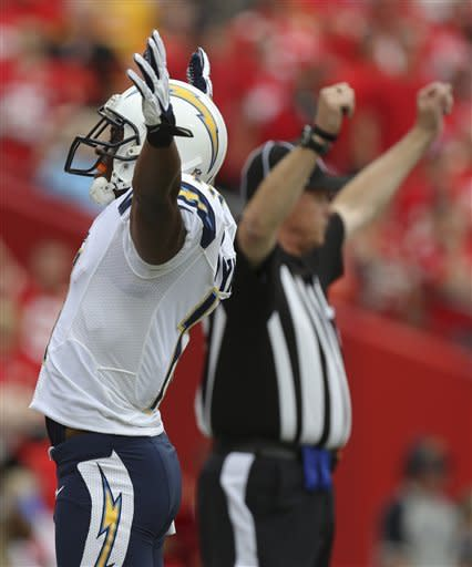 San Diego Chargers wide receiver Eddie Royal (11) celebrates a touchdown during the first half of an NFL football game against the Kansas City Chiefs at Arrowhead Stadium in Kansas City, Mo., Sunday, Sept. 30, 2012. (AP Photo/Ed Zurga)