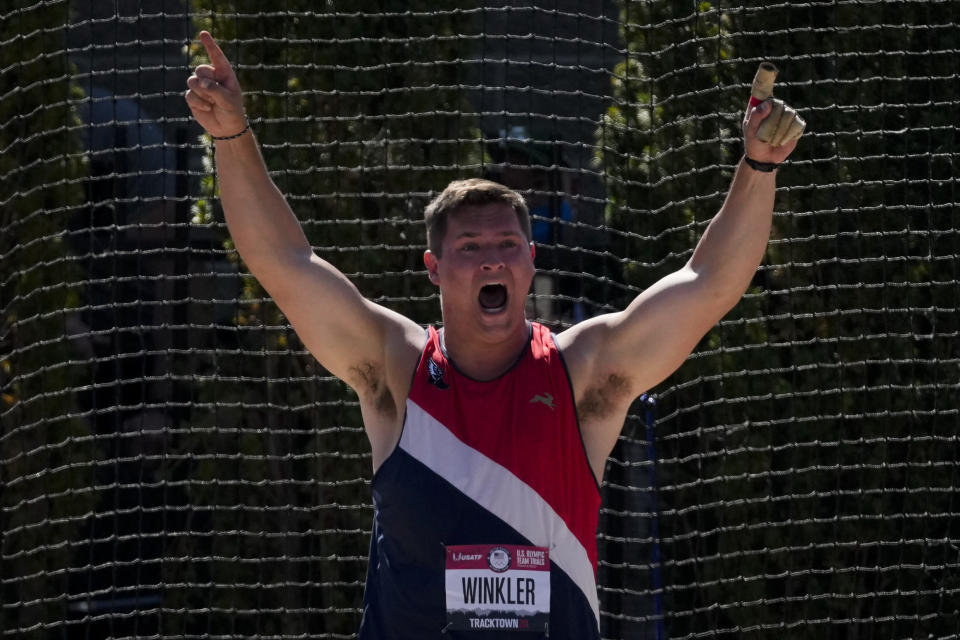 Rudy Winkler reacts after setting an American record during the finals of the men's hammer throw event at the U.S. Olympic Track and Field Trials Sunday, June 20, 2021, in Eugene, Ore. (AP Photo/Ashley Landis)
