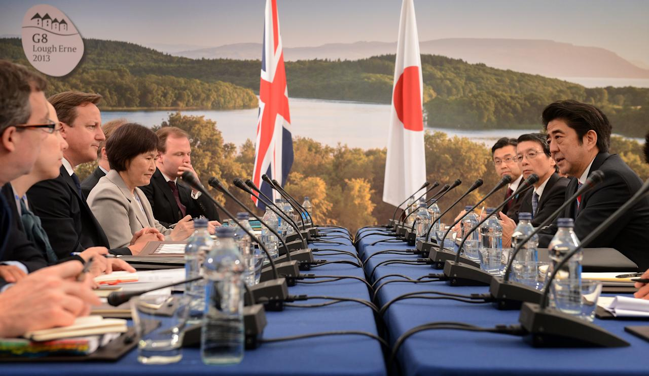 Britain's Prime Minister David Cameron (3rd L) holds a meeting with the Prime Minister of Japan Shinzo Abe (R) at the G8 Summit in Eniskillen, Northern Ireland June 17, 2013.  At the G8 Summit being held in the Lough Erne golf resort in Northern Ireland, Britain's Prime Minister David Cameron will bring together leaders of the United States, Japan, Canada, Russia, Germany, France and Italy - representing just over half of the $71.7 trillion global economy. REUTERS/Stefan Rousseau/Pool   (NORTHERN IRELAND - Tags: BUSINESS POLITICS)