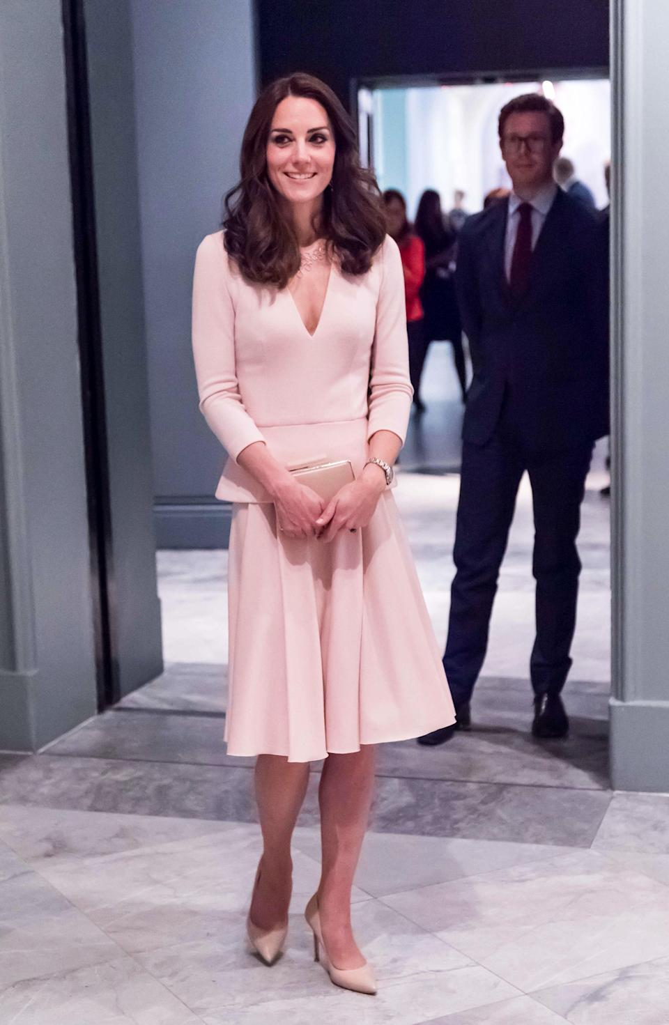 <p>The Duchess of Cambridge visited a Vogue exhibition at the National Portrait Gallery on May 4, 2016. For the event, she chose a sweet pink peplum dress by one of her favourite labels, Alexander McQueen. As usual, an L.K. Bennett clutch and shoes completed her ensemble. <em>[Photo: Getty]</em> </p>