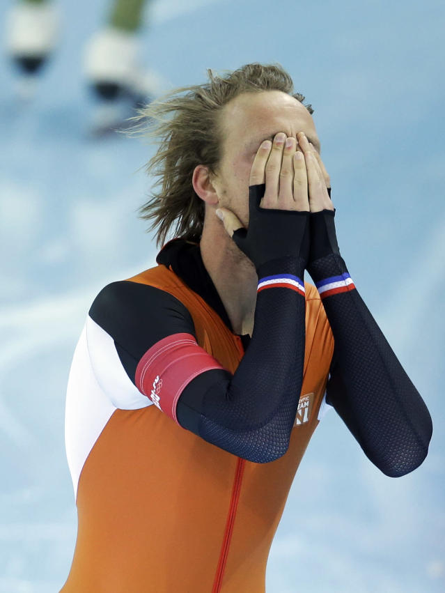 Gold medallist Michel Mulder from the Netherlands cups his face after his second heat race in the men's 500-meter speedskating race at the Adler Arena Skating Center during the 2014 Winter Olympics, Monday, Feb. 10, 2014, in Sochi, Russia. (AP Photo/Patrick Semansky)