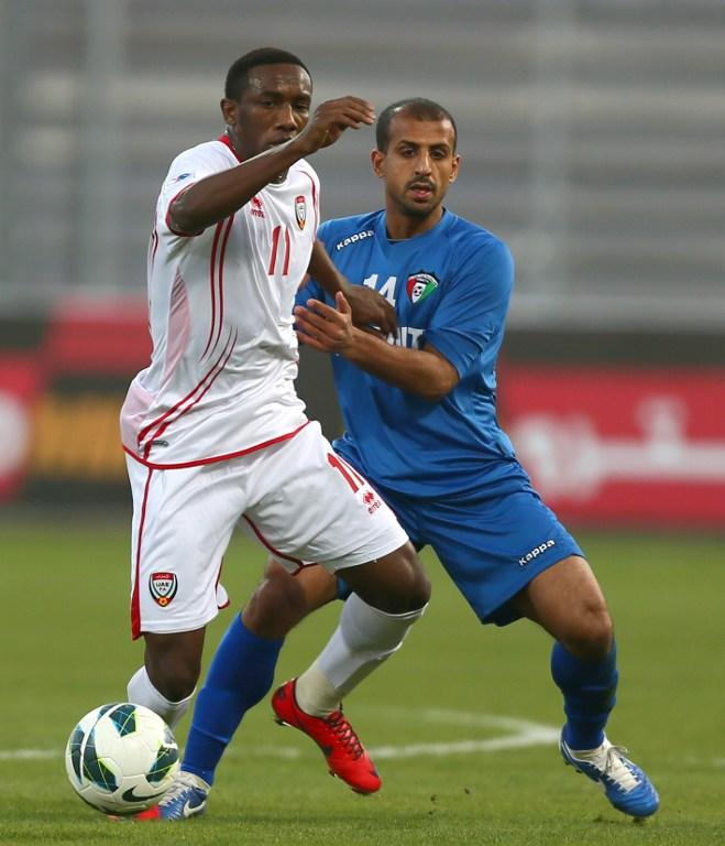 Ahmad Khalil Omar Abelahman (L) of United Arab Emirates vies for the ball against Husain al-Shammari of Kuwait during the two teams' semi-final match in the 21st Gulf Cup in Manama,on January 15, 2013. AFP PHOTO/MARWAN NAAMANI