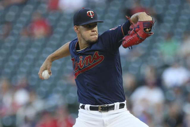 Minnesota Twins pitcher Jose Berrios throws to a Washington Nationals batter during the first inning of a baseball game Tuesday, Sept. 10, 2019, in Minneapolis. (AP Photo/Jim Mone)
