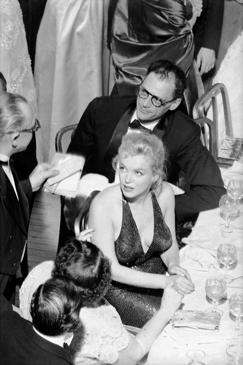 <p>Marilyn Monroe and her third husband, Arthur Miller, were spotted at the infamous April in Paris Ball in New York City. The event was a sophisticated social calendar staple, held at the Waldorf Astoria, and was attended by socialites such as Lee Radziwill. </p>