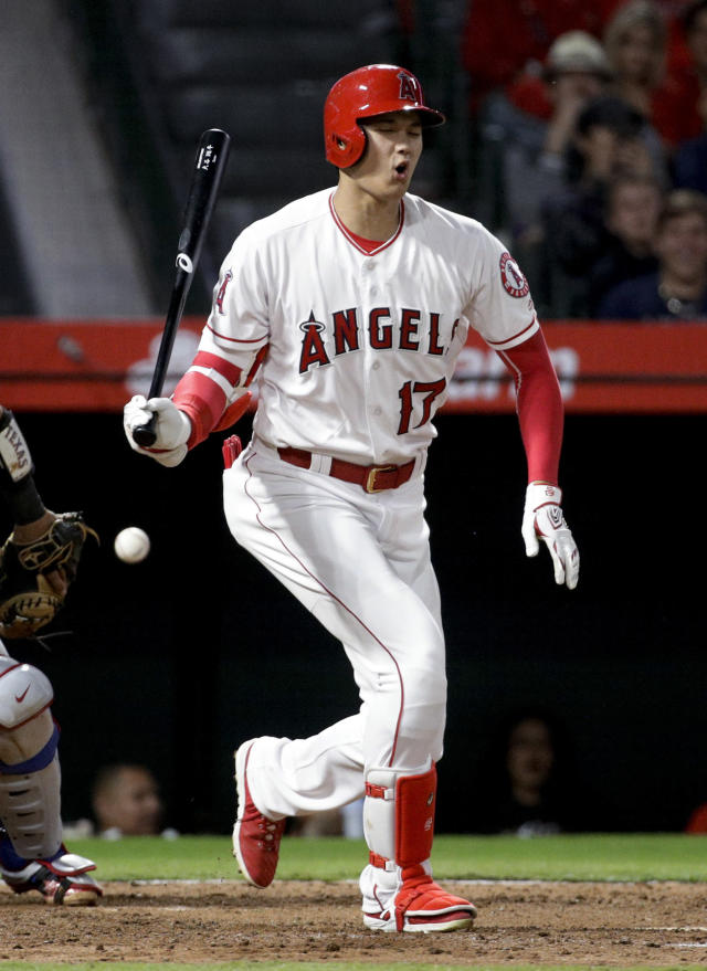 Los Angeles Angels' Shohei Ohtani, of Japan, fouls a ball off his foot during the sixth inning of the team's baseball game against the Texas Rangers in Anaheim, Calif., Tuesday, Sept. 25, 2018. (AP Photo/Chris Carlson)