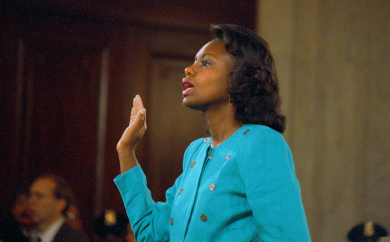 Anita Hill being sworn in before testifying at the Senate Judiciary hearing on Thomas' Supreme Court nomination.