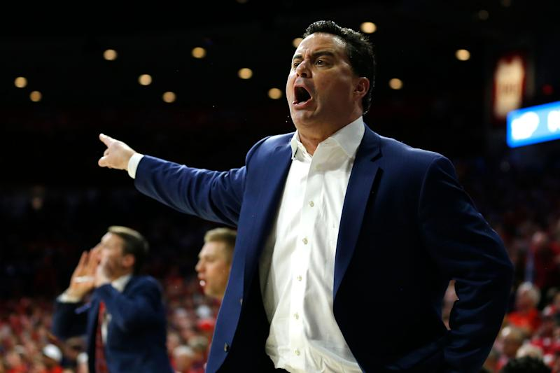 A federal judge ruled that Sean Miller, pictured, and Will Wade won't have to testify at a college basketball corruption trial. (AP)