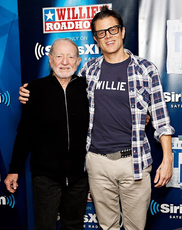 NEW YORK, NY - NOVEMBER 20:  Willie Nelson and Johnny Knoxville pose in the green room before the SiriusXM Townhall with Willie Nelson and Johnny Knoxville on Willie's Roadhouse at SiriusXM Studios on November 20, 2012 in New York City.  (Photo by Cindy Ord/Getty Images)
