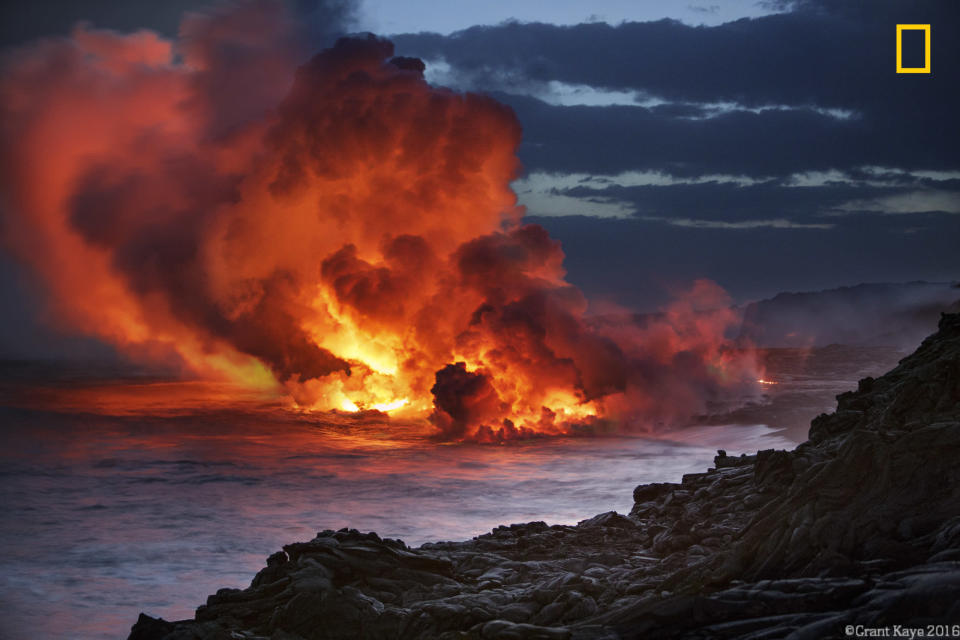 <p>Lava flows into the ocean at sunset in kamokuna, Kalapana, Hawaii. (Grant Kaye/National Geographic Nature Photographer of the Year contest) </p>
