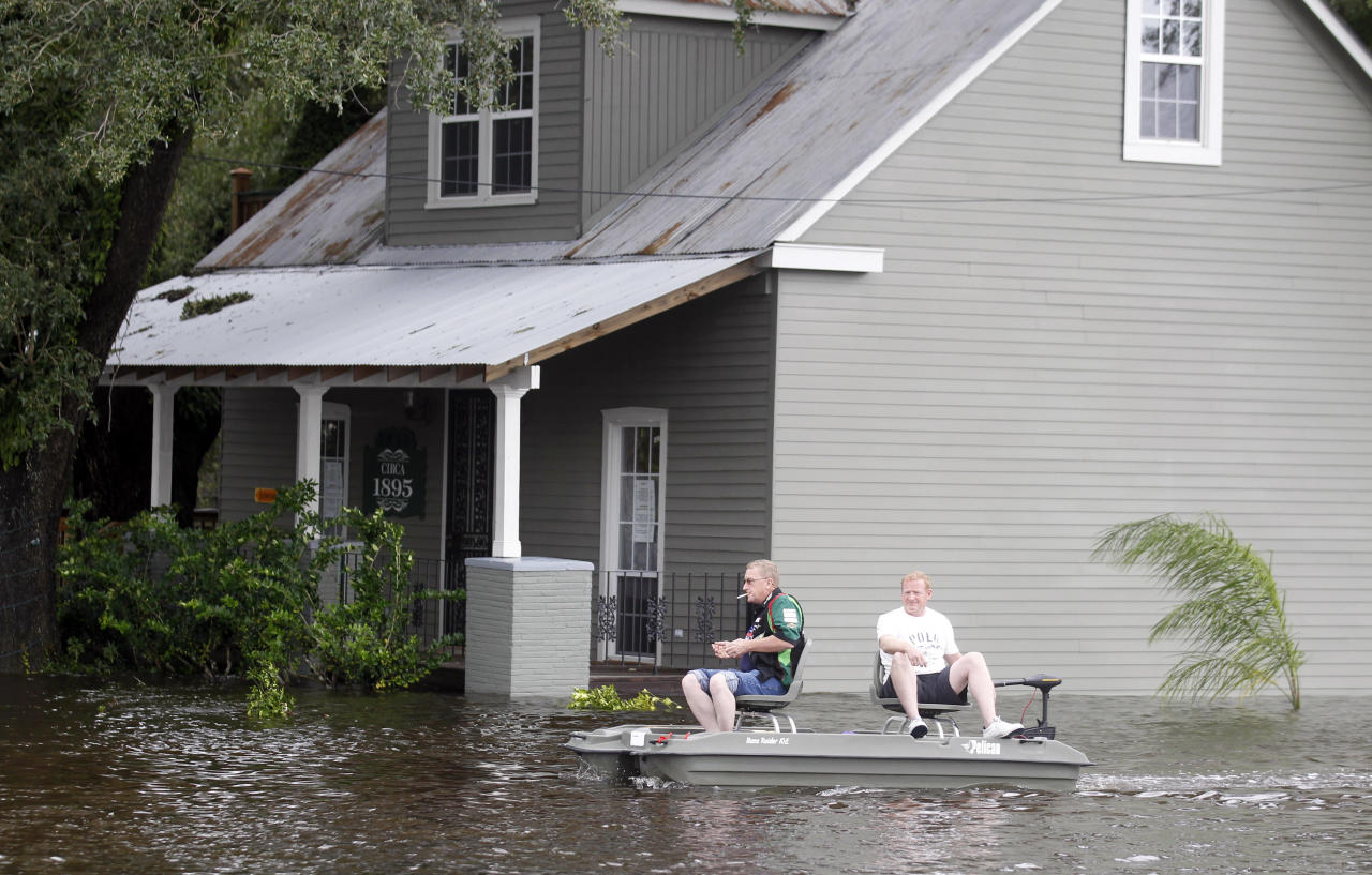 Two men use small boat to travel though flooded streets Thursday, Aug. 30, 2012, in Slidell, La. Isaac's maximum sustained winds had decreased to 45 mph and the National Hurricane Center said it was expected to become a tropical depression by Thursday night. (AP Photo/John Bazemore)