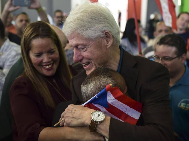 Hurricane Maria: Bill Clinton personally hands out supplies in Puerto Rico to survivors