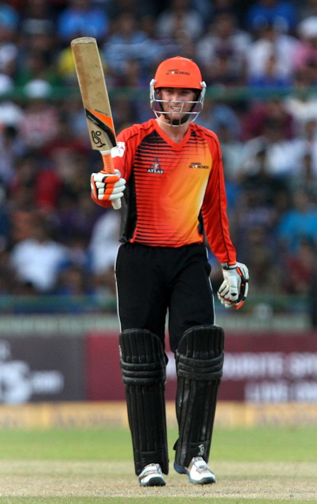 Sam Whiteman of Perth Scorchers celebrates his 50 during the CLT20 match between Perth Scorchers and Mumbai Indians at Feroz Shah Kotla, Delhi on Oct. 2, 2013. (Photo: IANS)