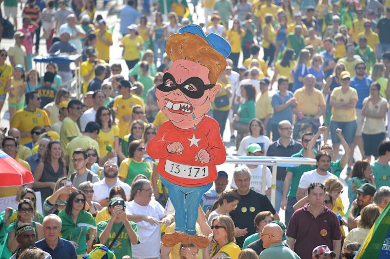 Less than a year into her second term, Dilma Rousseff is on the ropes as the world's seventh-largest economy slides into recession (AFP Photo/Nelson Almeida)