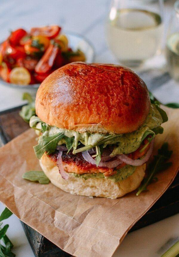 """<p>Mix up your typical burger night with these tasty pan-fried salmon burgers. The homemade green goddess dressing is packed with fresh herbs like tarragon, dill, parsley, and basil. Warning: You'll want to put it on everything.</p><p><strong>Get the recipe at <a href=""""https://thewoksoflife.com/salmon-burgers-green-goddess/"""" rel=""""nofollow noopener"""" target=""""_blank"""" data-ylk=""""slk:The Woks of Life"""" class=""""link rapid-noclick-resp"""">The Woks of Life</a>. </strong> </p>"""