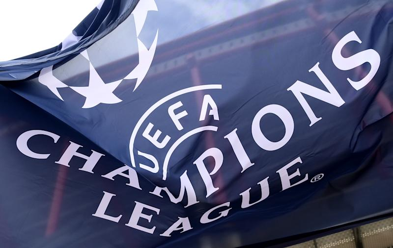 The UEFA Champions League logo is shown on a banner.