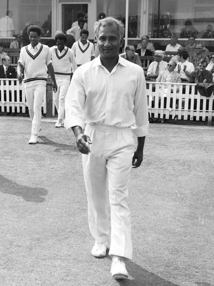 Guyanan-born West Indian cricketer Rohan Babulal Kanhai, one of the West Indies' leading batsman of the 1960's and 1970's, walking out to play during one of the several seasons he played for Warwickshire.    (Photo by Evening Standard/Getty Images)